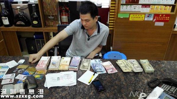 图为<a href=http://www.szxxg.com/shenzhen/ target=_blank class=infotextkey>深圳</a>(www.szxxg.com)警方破获重大地下钱庄案件中查获的银行卡及外币